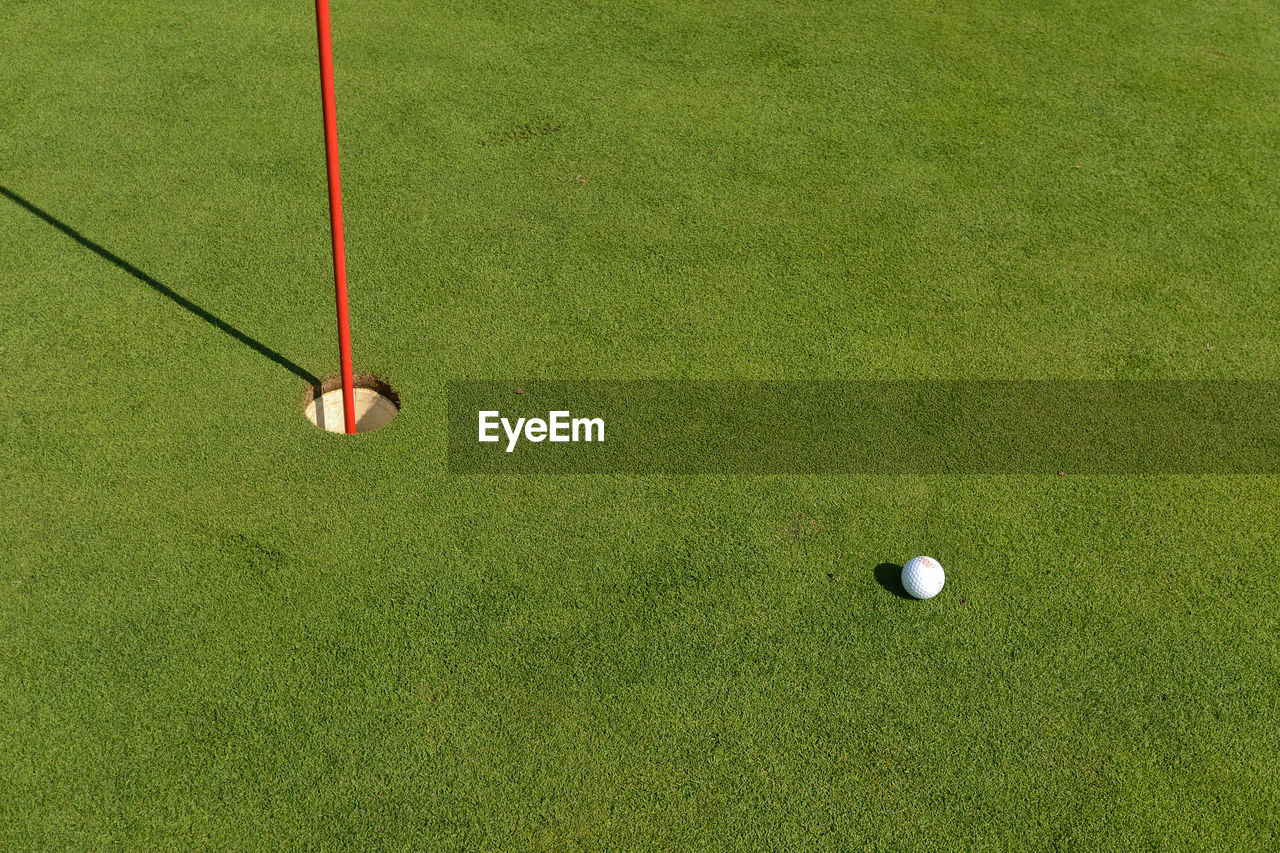 High Angle View Of Ball On Field At Golf Course