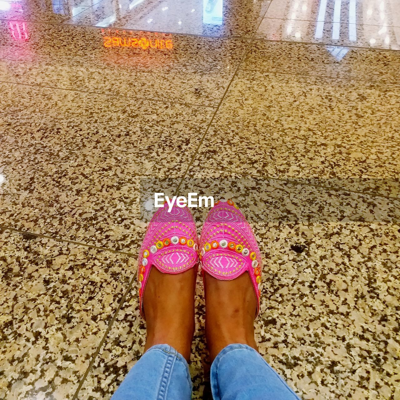 low section, human leg, one person, human body part, body part, shoe, real people, standing, women, personal perspective, lifestyles, leisure activity, day, adult, pink color, nature, casual clothing, outdoors, human foot, human limb, jeans