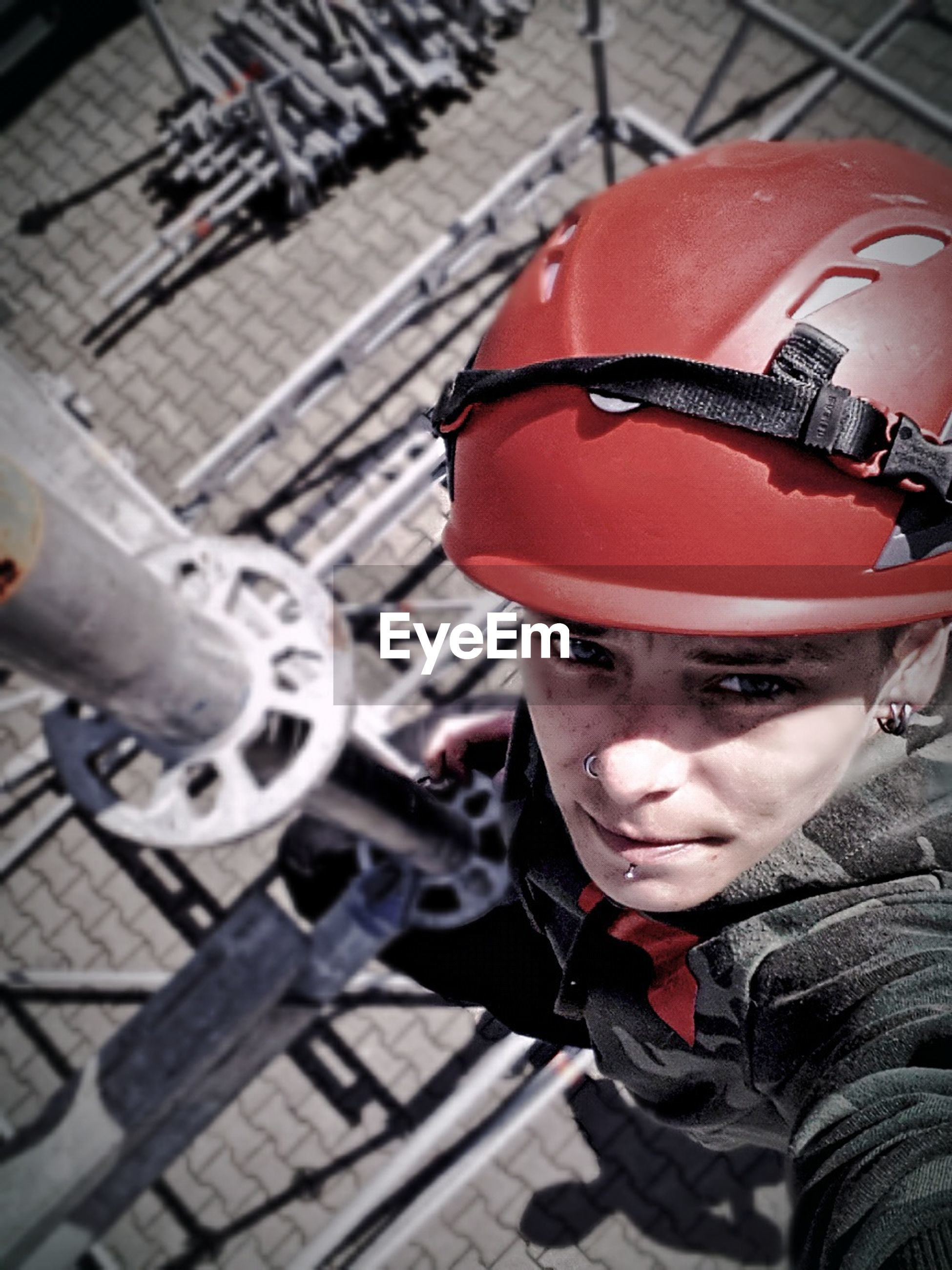 High angle portrait of female worker working on scaffolding