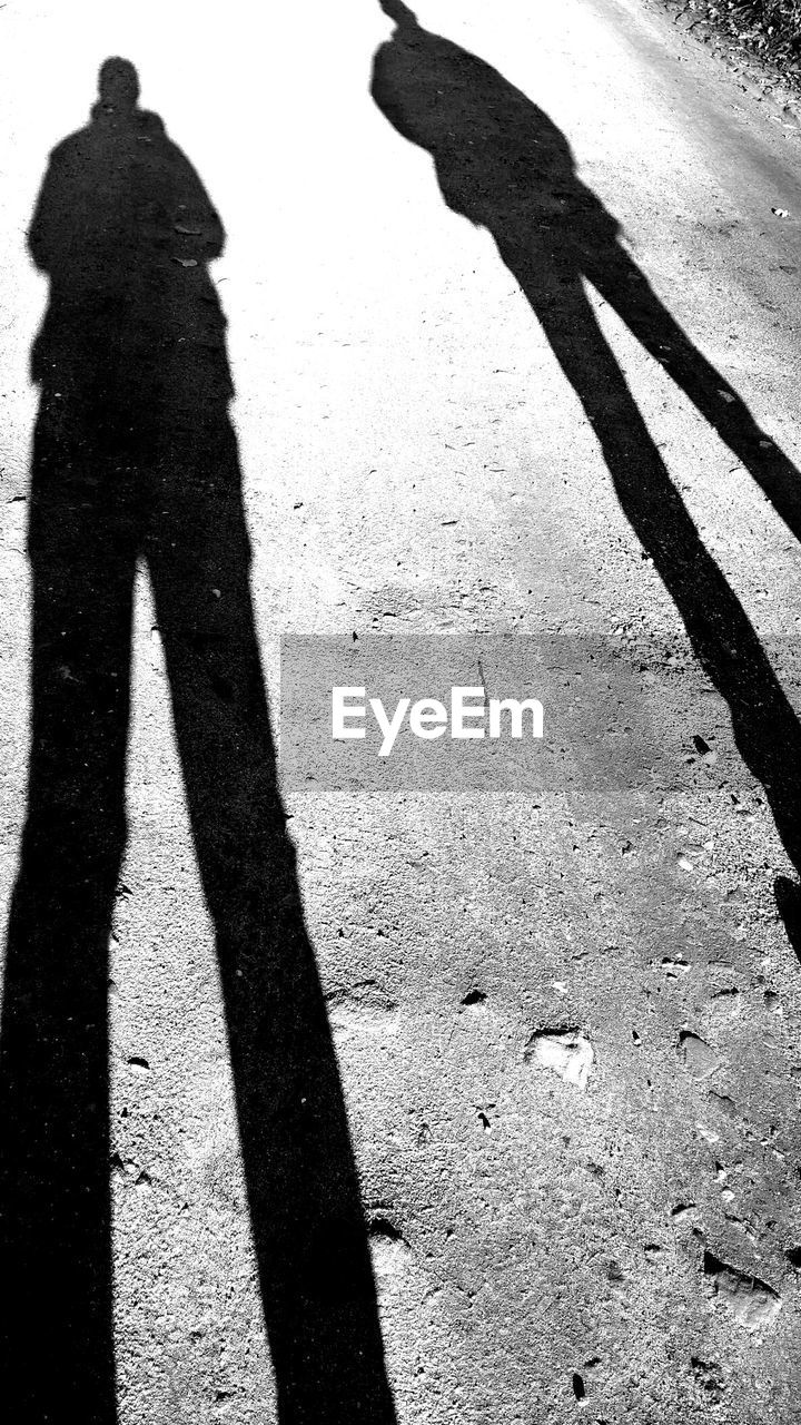 shadow, focus on shadow, real people, one person, lifestyles, day, standing, sunlight, silhouette, high angle view, men, outdoors, leisure activity, low section, one man only, adult, people