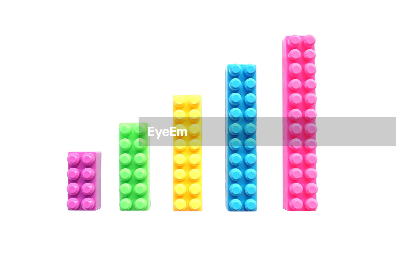 High angle view of colorful toy blocks on white background