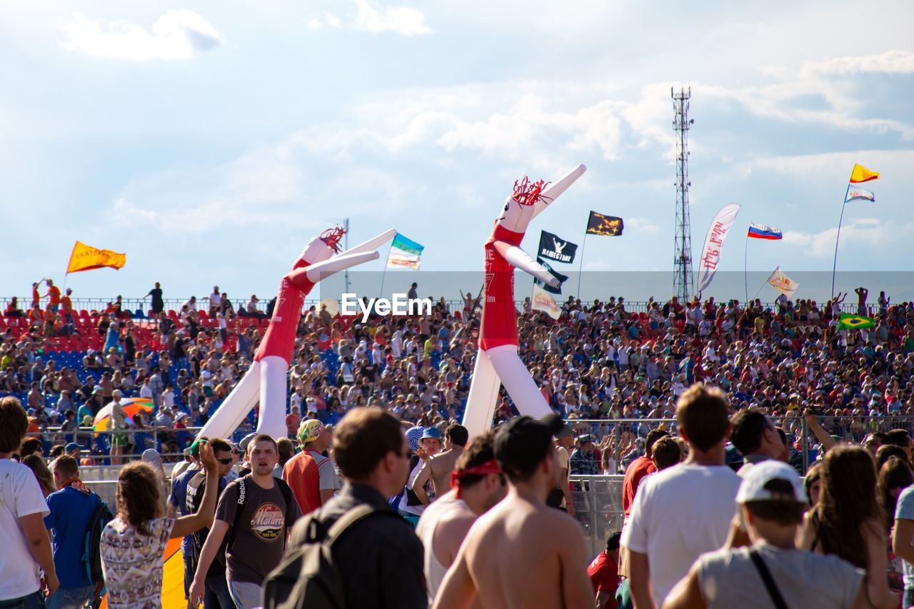 crowd, group of people, real people, large group of people, men, event, flag, togetherness, spectator, day, women, audience, arts culture and entertainment, festival, sky, nature, enjoyment, outdoors, celebration, music festival, watching, human arm, arms raised