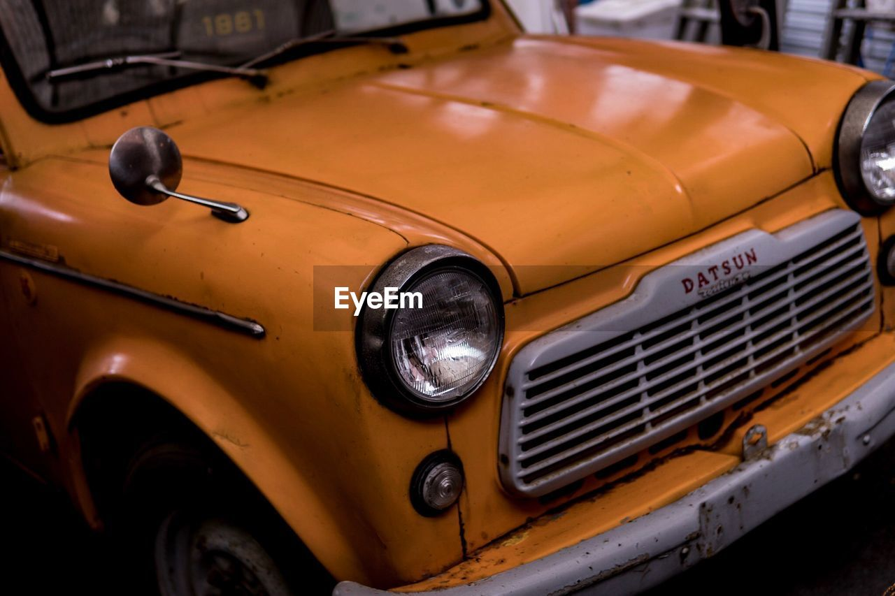 headlight, mode of transport, vintage car, retro styled, transportation, land vehicle, old-fashioned, car, vintage, outdoors, no people, day, close-up