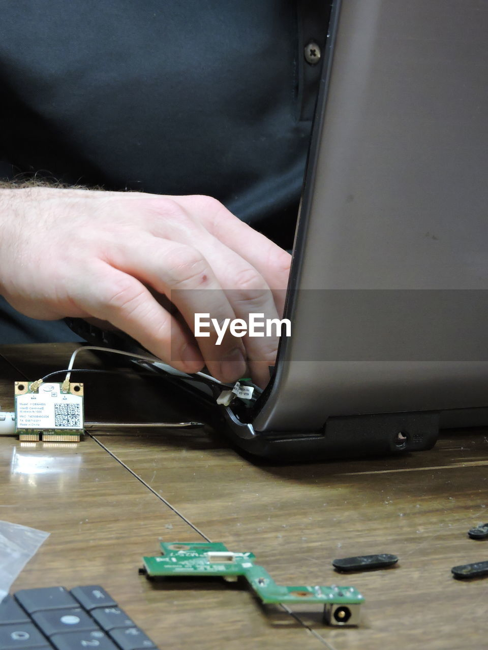 Engineer Repairing Equipment At Desk