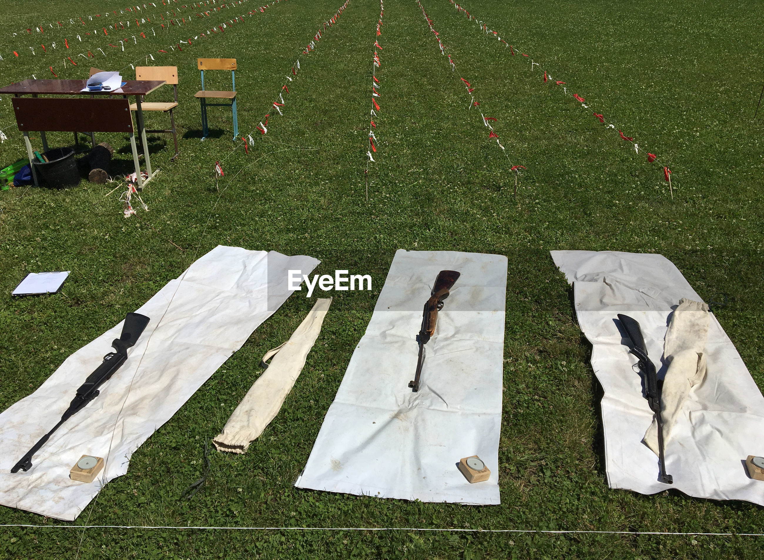 HIGH ANGLE VIEW OF DRYING ON FIELD