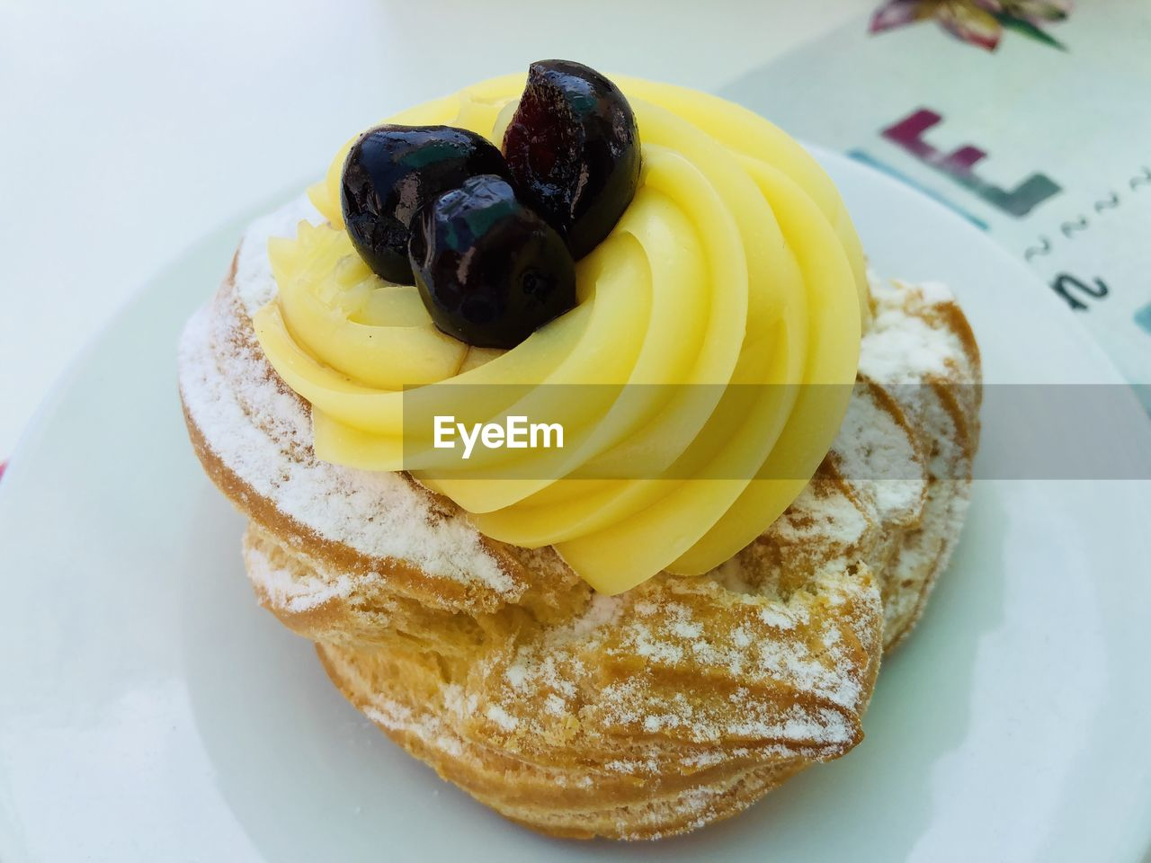 food, food and drink, plate, sweet food, indulgence, freshness, cake, still life, fruit, ready-to-eat, temptation, sweet, dessert, indoors, yellow, high angle view, close-up, no people, blueberry, healthy eating, breakfast, snack