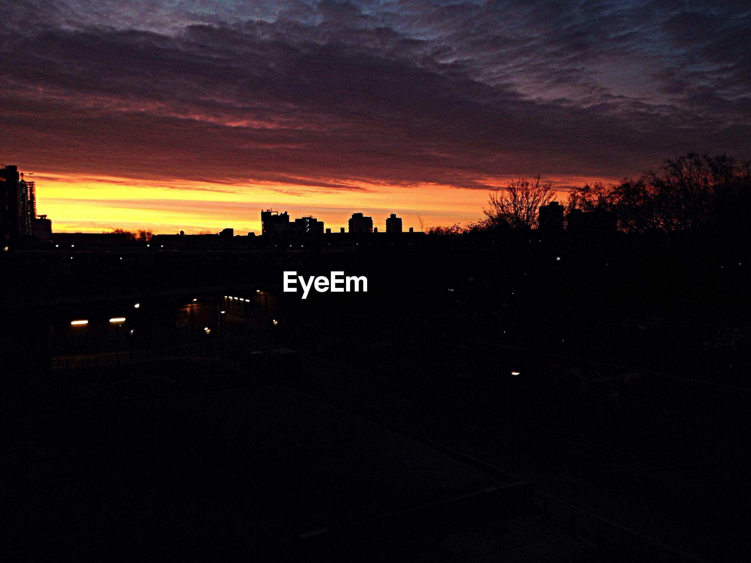 Silhouette landscape against dramatic sky