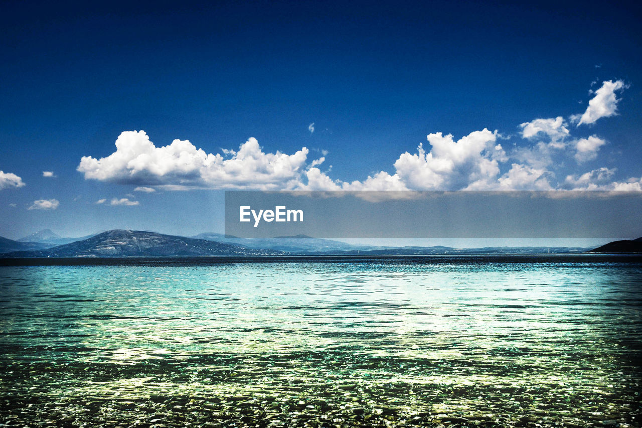 sky, scenics - nature, cloud - sky, beauty in nature, water, tranquility, tranquil scene, mountain, sea, nature, blue, day, waterfront, no people, idyllic, outdoors, mountain range, remote, non-urban scene, turquoise colored