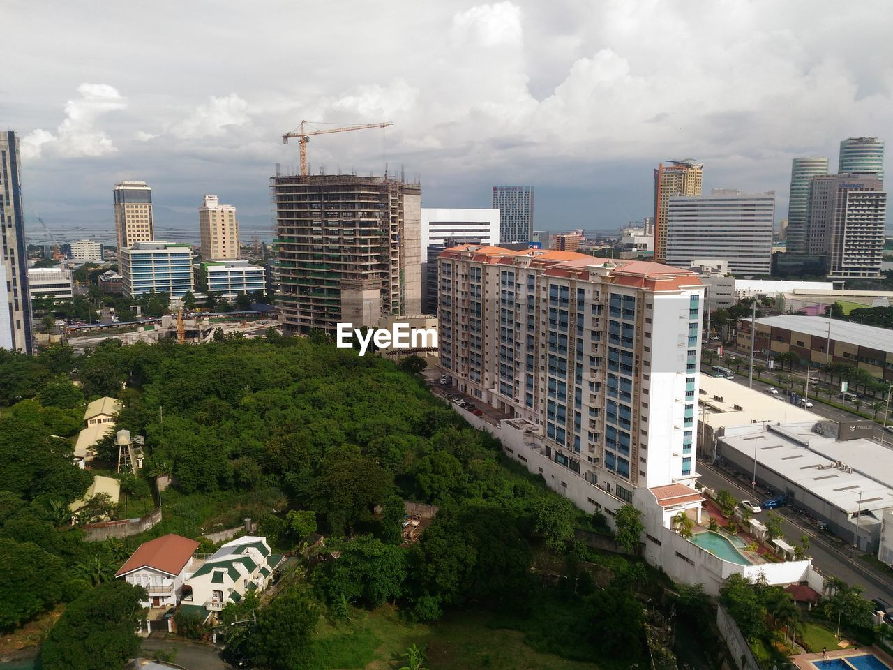 building exterior, architecture, cloud - sky, built structure, city, tree, skyscraper, modern, sky, residential building, cityscape, outdoors, no people, growth, day