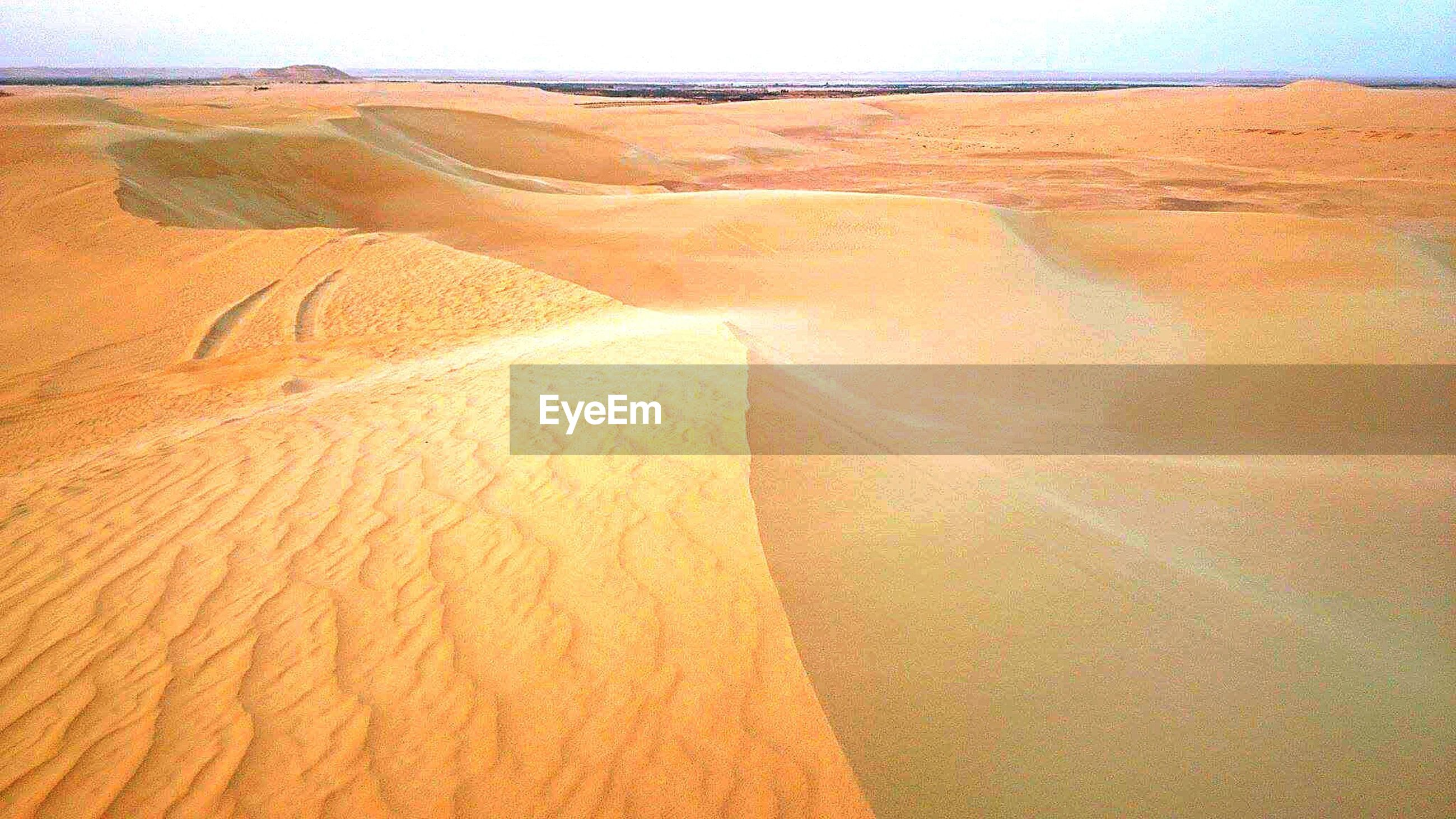 landscape, arid climate, nature, physical geography, outdoors, scenics, day, sand dune, desert, sand, beauty in nature, travel destinations, no people, tranquility, aerial view, sky