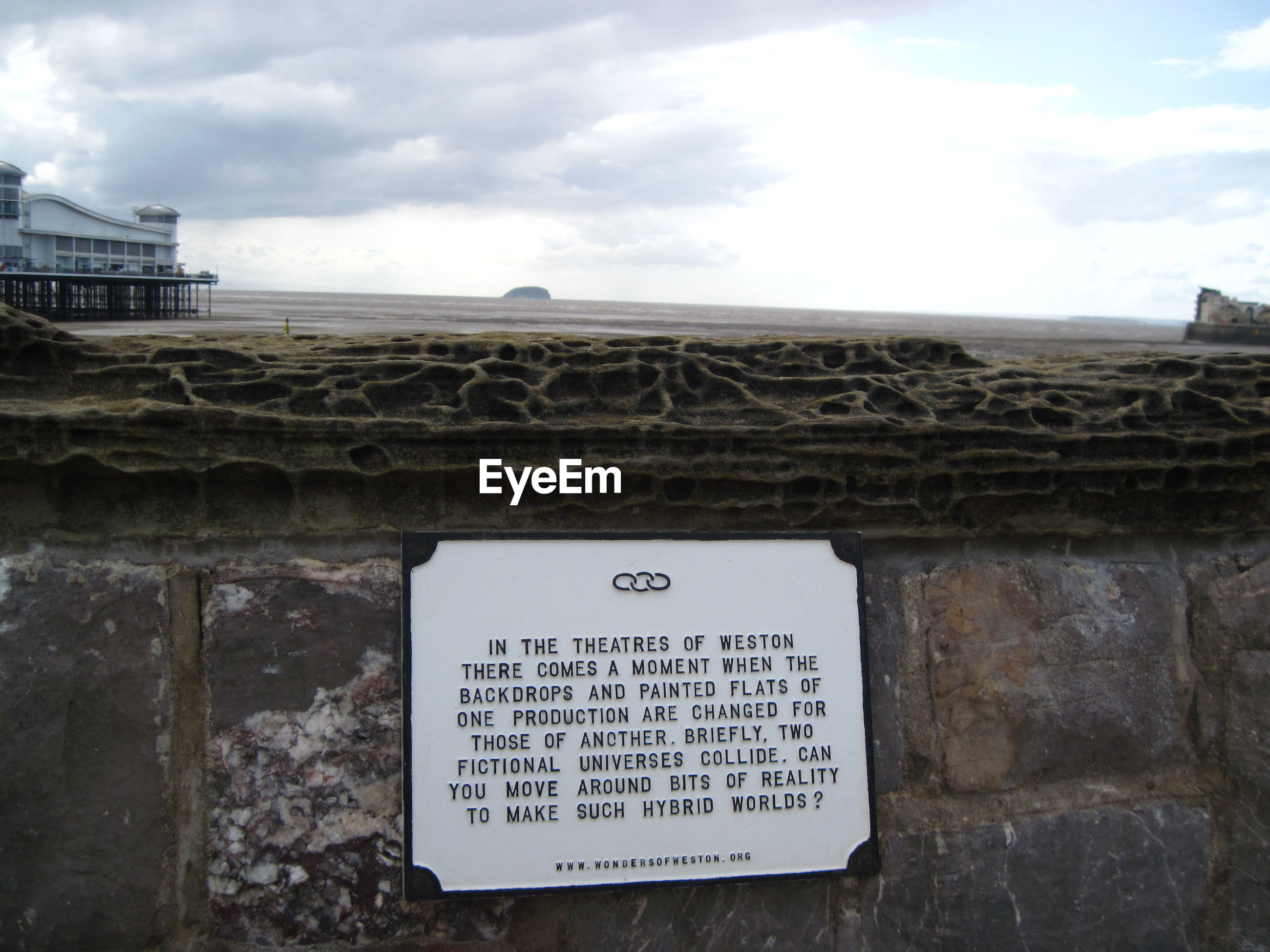 INFORMATION SIGN ON BUILDING AGAINST SKY