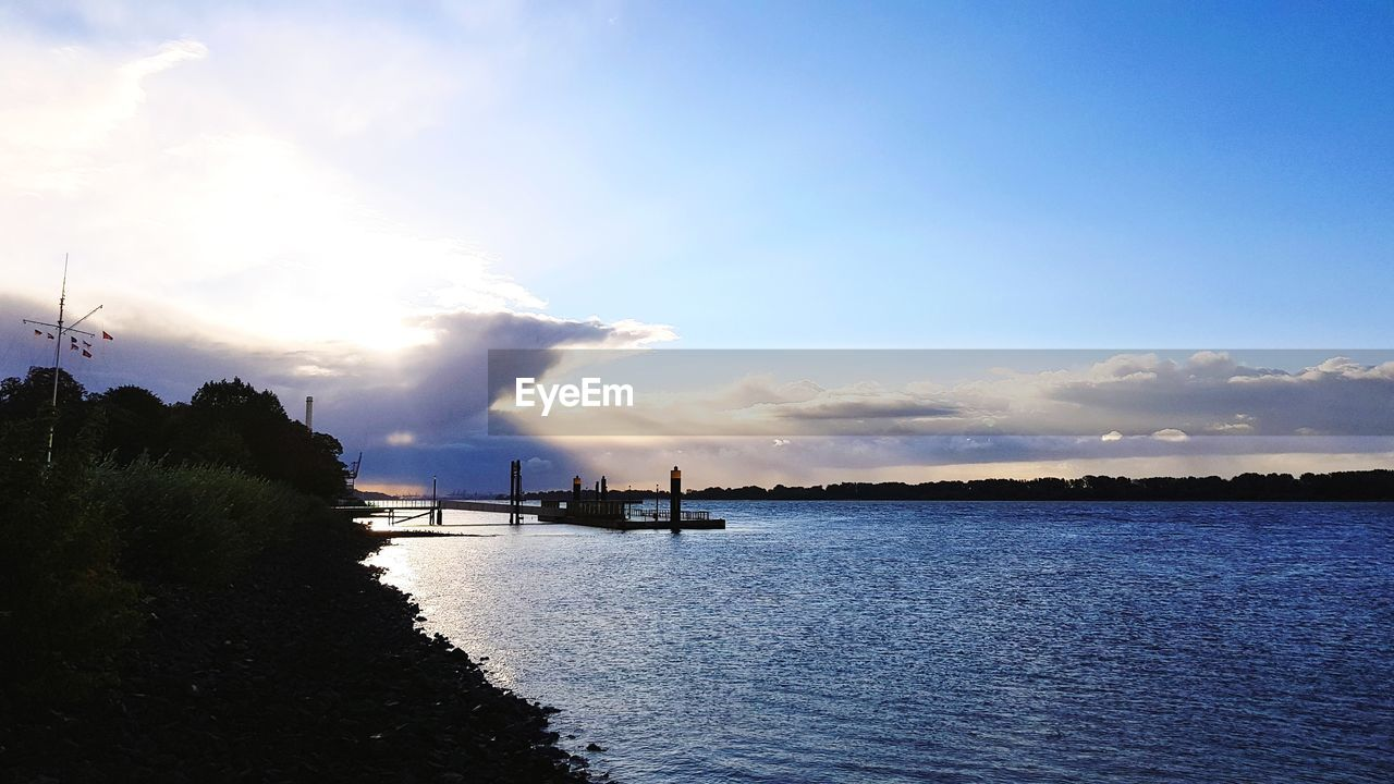 water, sky, cloud - sky, scenics - nature, waterfront, beauty in nature, nature, nautical vessel, industry, no people, transportation, tranquility, tranquil scene, outdoors, day, non-urban scene, architecture, river