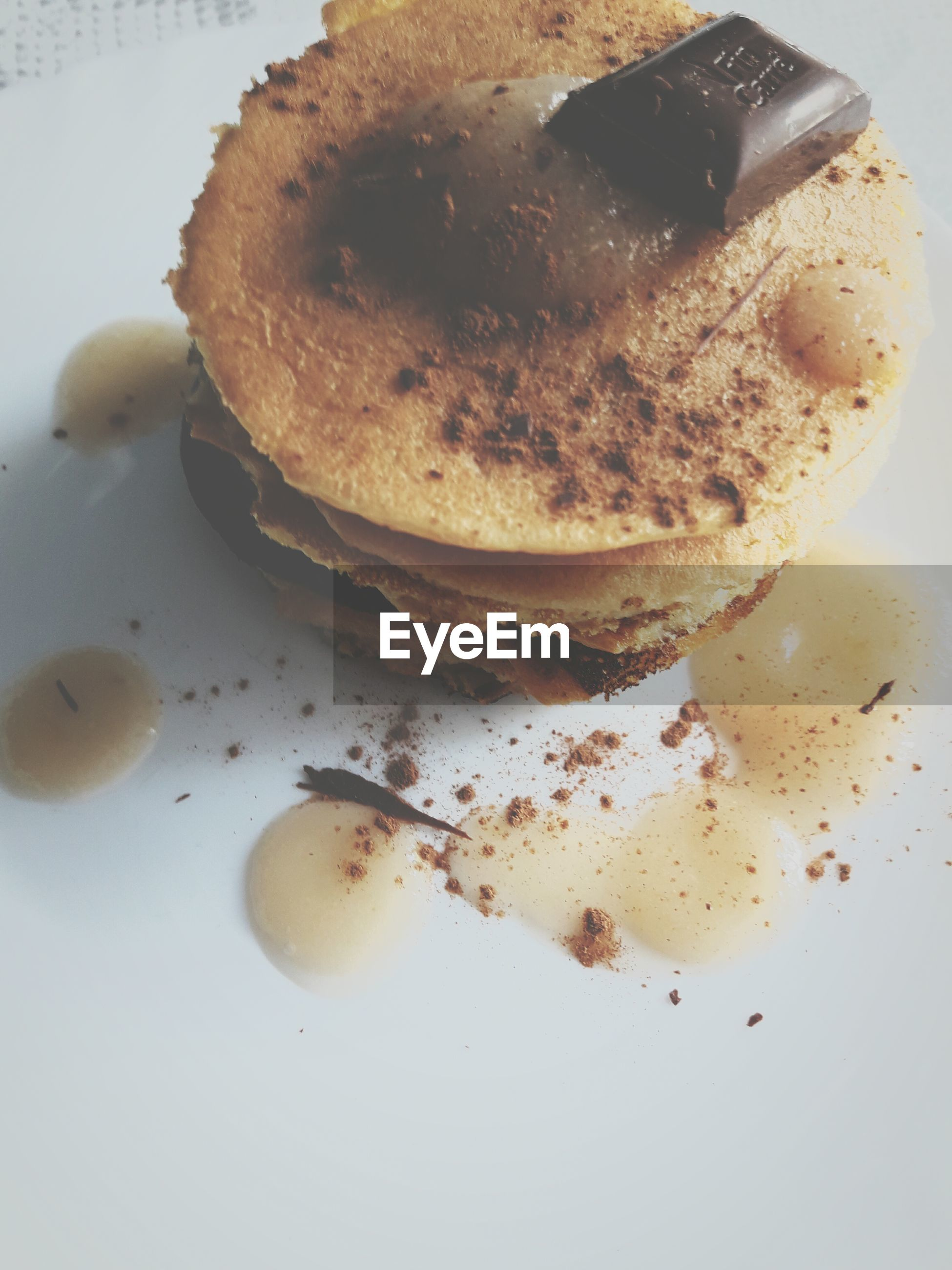 Close-up of pancakes with chocolate in plate