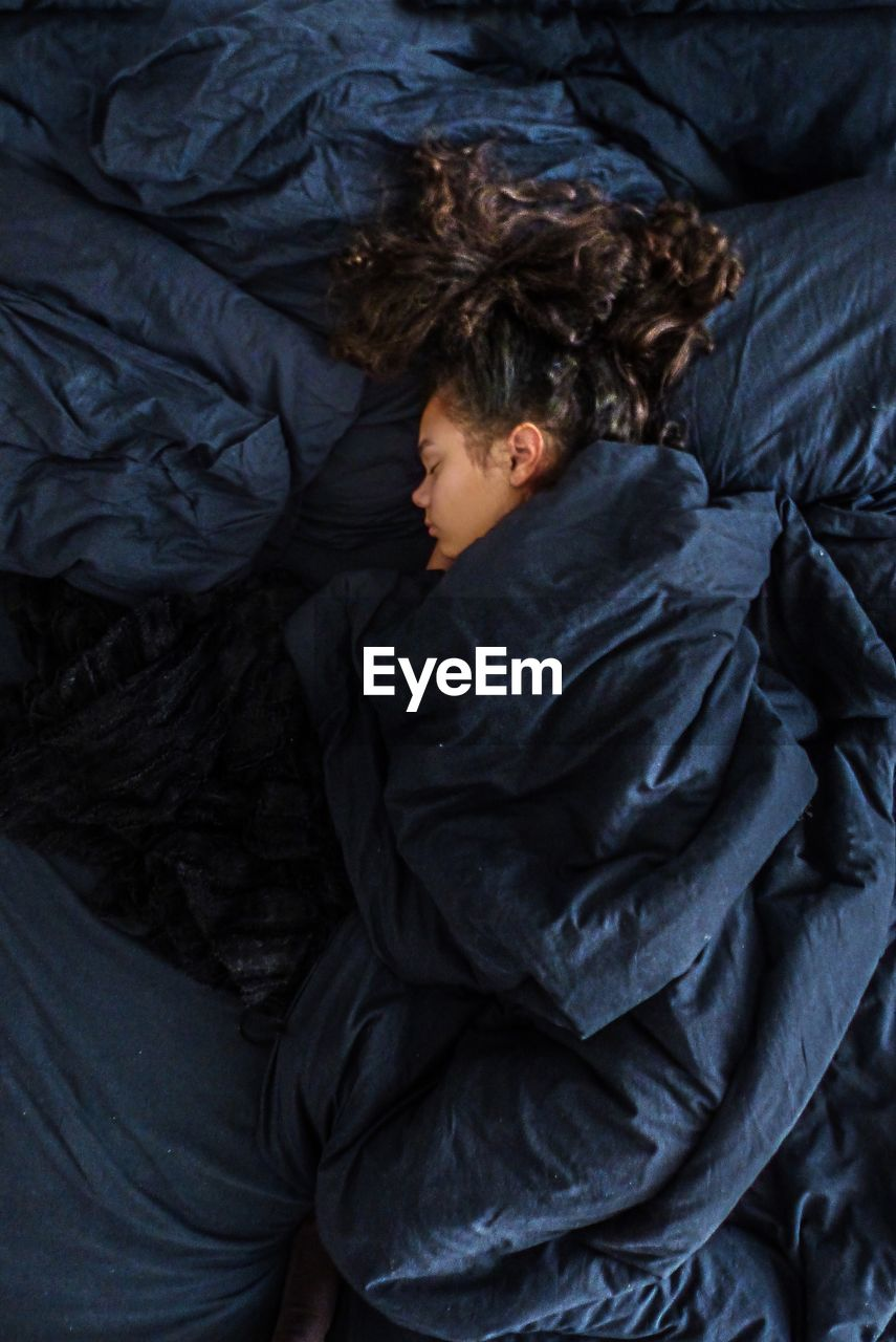 High Angle View Of Girl Sleeping In Bed