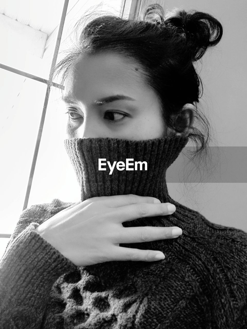 one person, headshot, portrait, young adult, front view, real people, indoors, sweater, lifestyles, young women, looking at camera, warm clothing, clothing, leisure activity, winter, women, close-up, adult, turtleneck, hairstyle, scarf, human face, obscured face, beautiful woman, contemplation