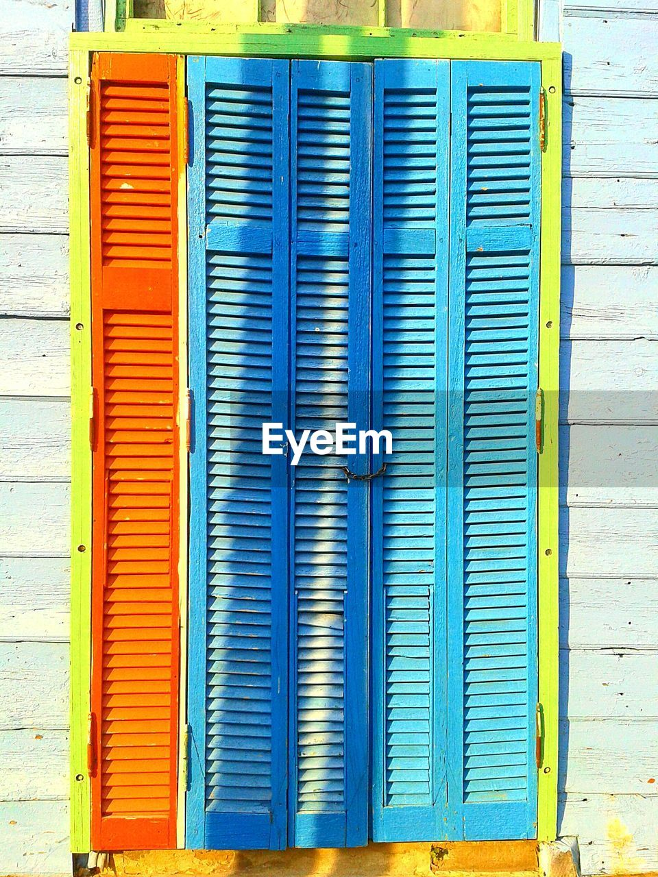 blue, shutter, closed, no people, metal, day, pattern, architecture, safety, security, full frame, built structure, multi colored, wall - building feature, protection, corrugated iron, outdoors, iron, textured, backgrounds
