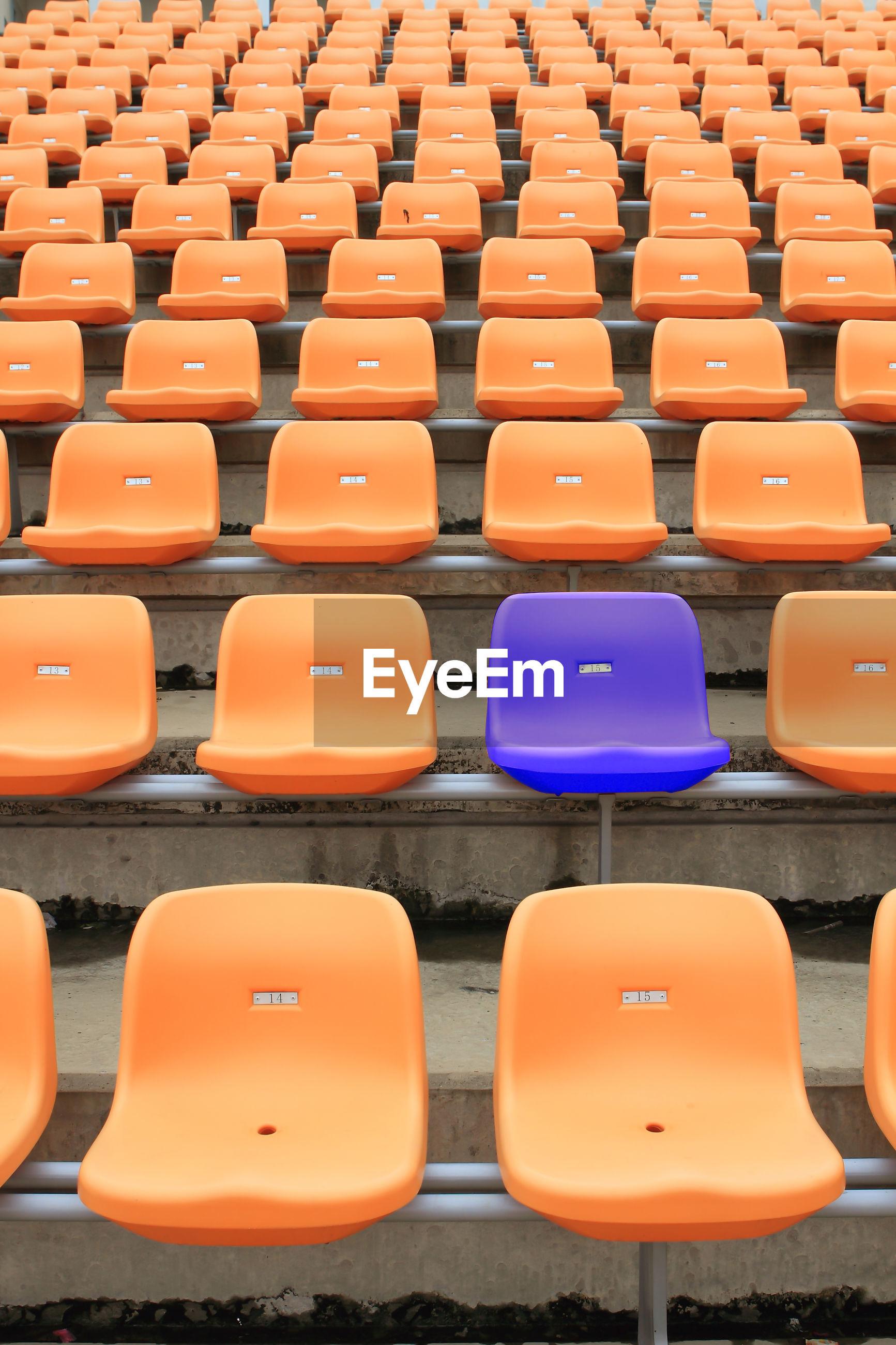 Full frame shot of empty seats at stadium