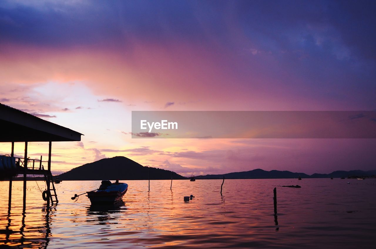 water, sky, sunset, beauty in nature, cloud - sky, scenics - nature, nautical vessel, silhouette, orange color, waterfront, transportation, mode of transportation, tranquil scene, tranquility, nature, real people, sea, idyllic, outdoors