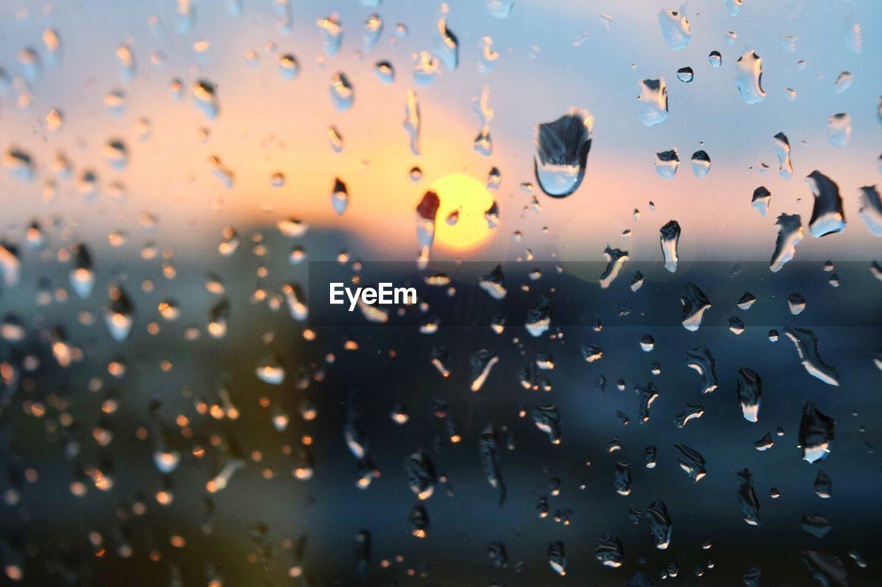 Full Frame Shot Of Wet Glass During Monsoon