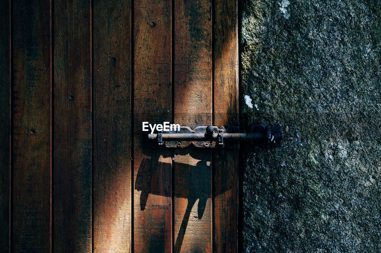 Old Latch On Wooden Door