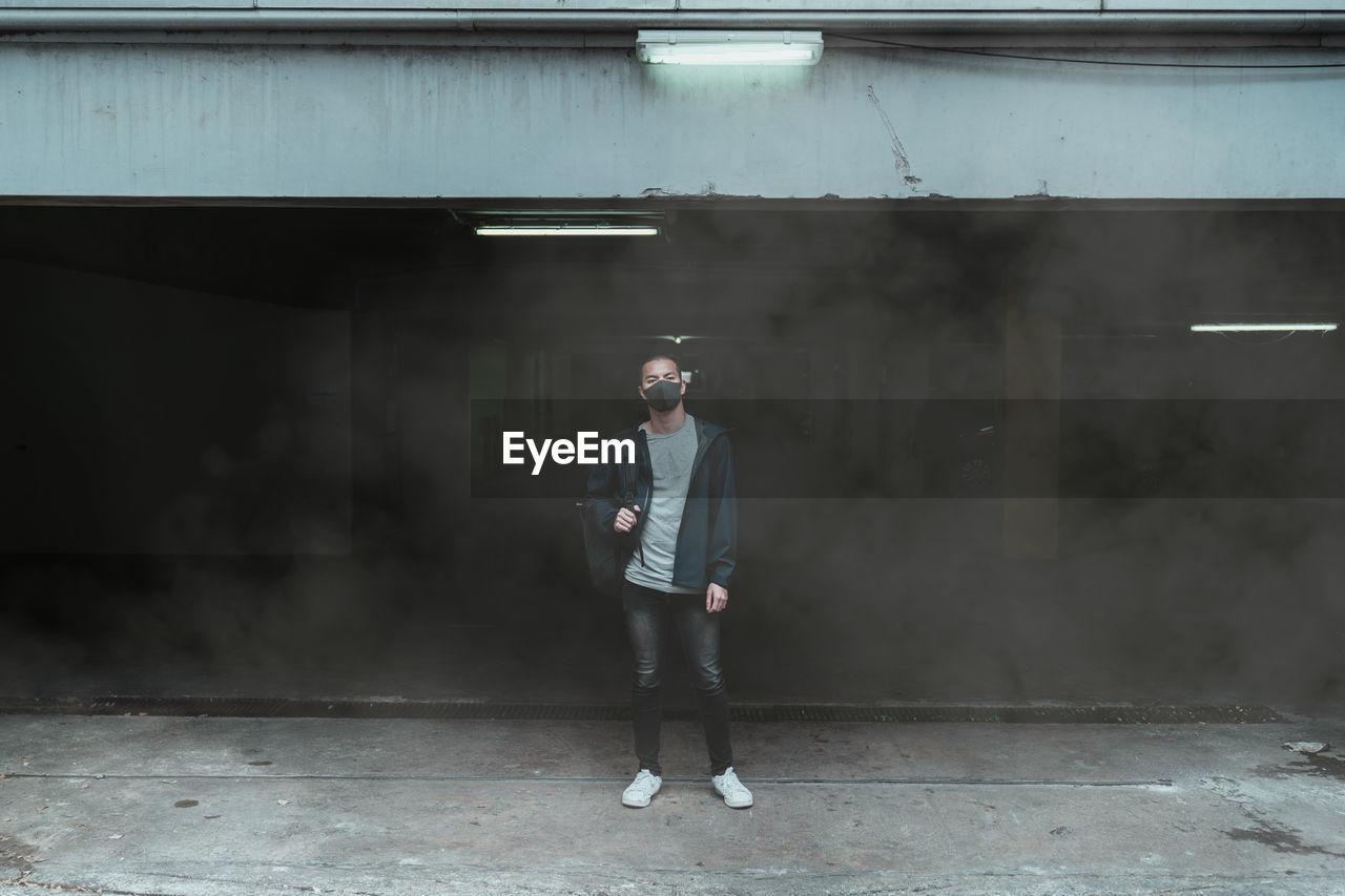 Full length of man standing in smoke
