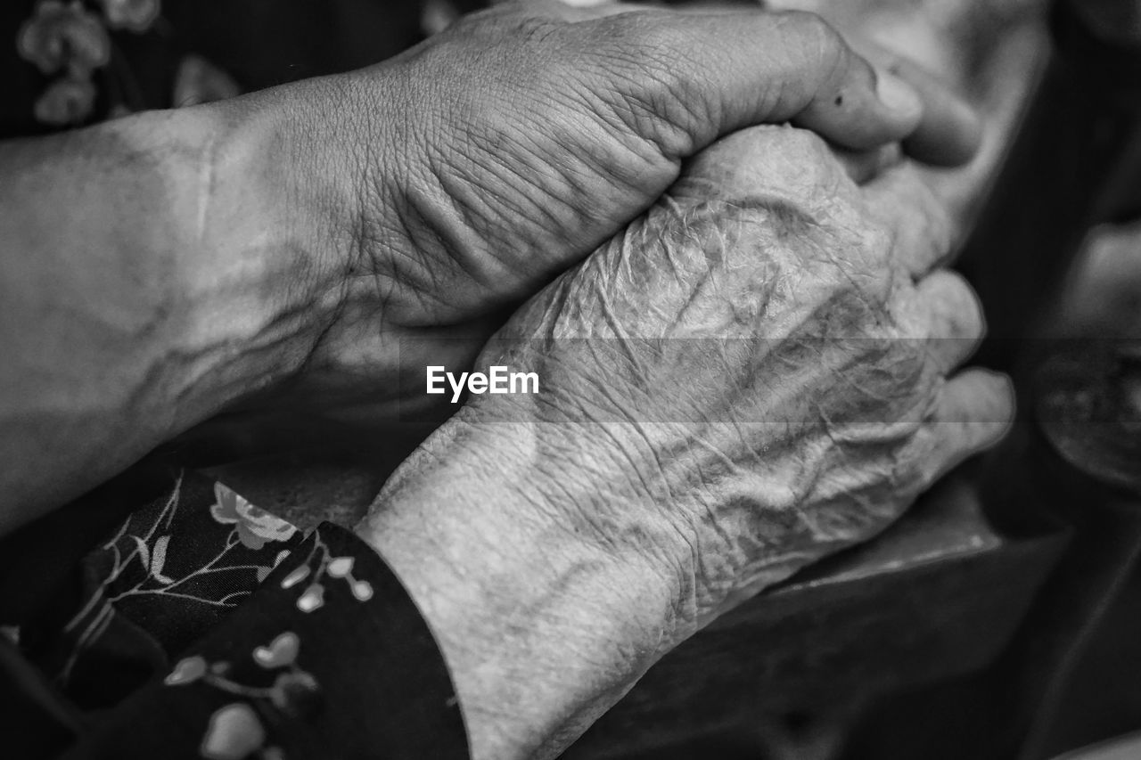 human hand, hand, human body part, real people, wrinkled, senior adult, body part, close-up, men, people, adult, two people, senior men, focus on foreground, bonding, finger, unrecognizable person, lifestyles, human finger, care