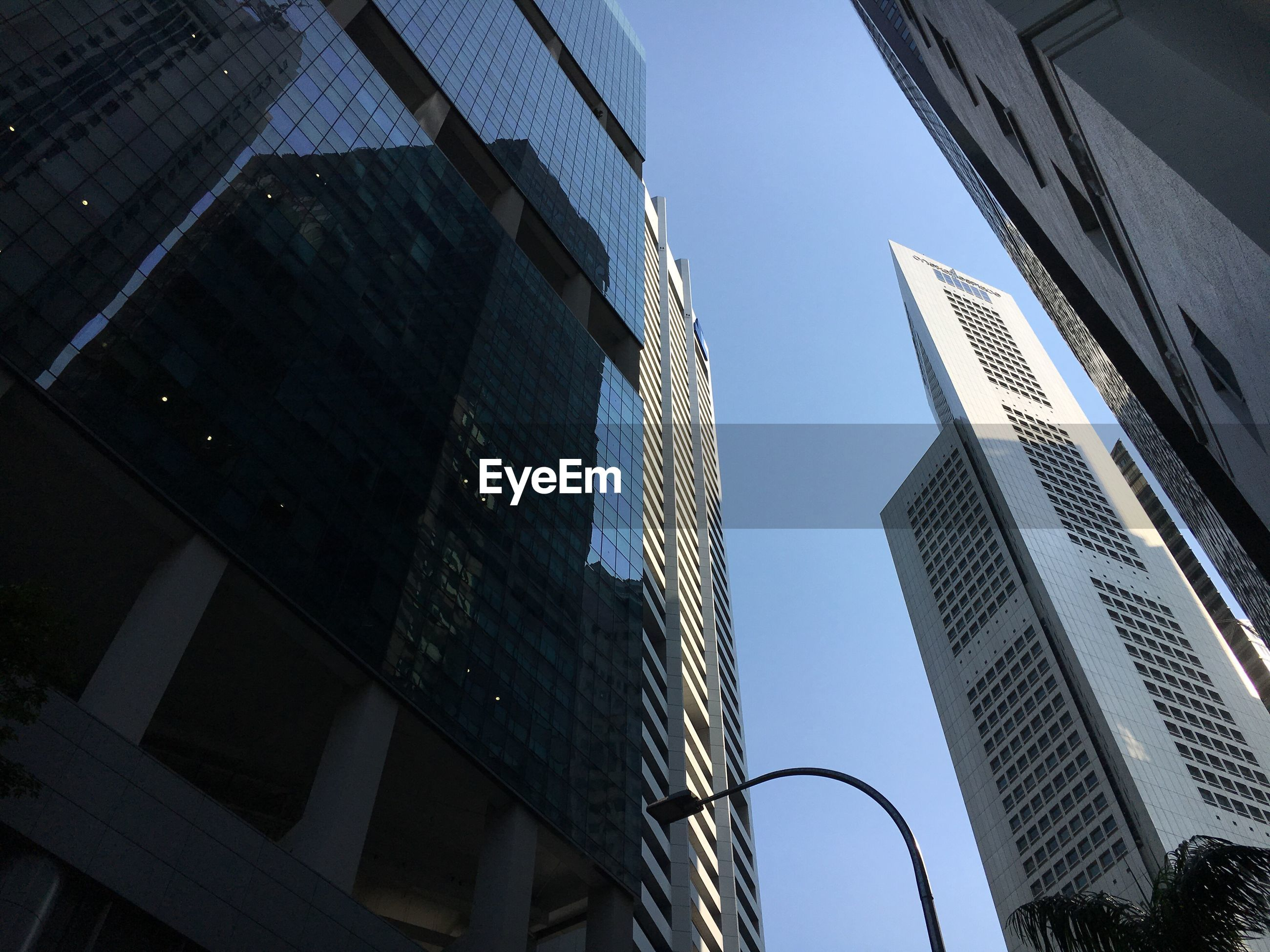 LOW ANGLE VIEW OF MODERN SKYSCRAPERS AGAINST CLEAR SKY