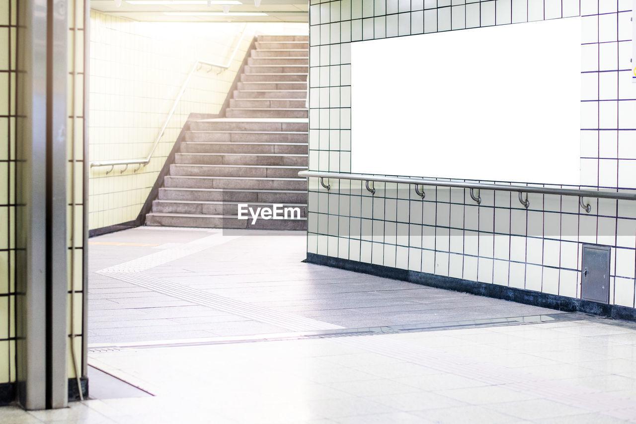 Blank billboard at subway station