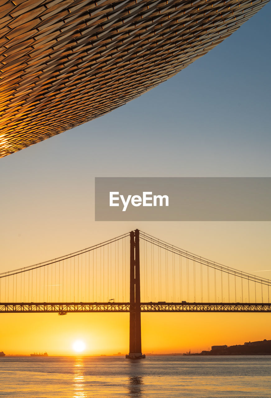 sky, bridge, built structure, water, architecture, bridge - man made structure, connection, sunset, sea, suspension bridge, no people, nature, beauty in nature, clear sky, travel destinations, tranquility, scenics - nature, tranquil scene