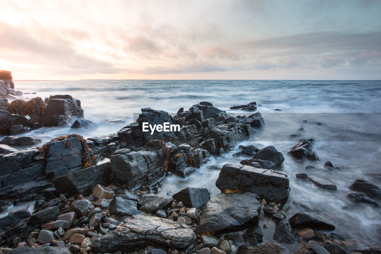 sea, sky, water, rock, horizon over water, beauty in nature, scenics - nature, solid, horizon, rock - object, beach, motion, cloud - sky, sunset, land, nature, long exposure, no people, idyllic, outdoors, rocky coastline, breaking