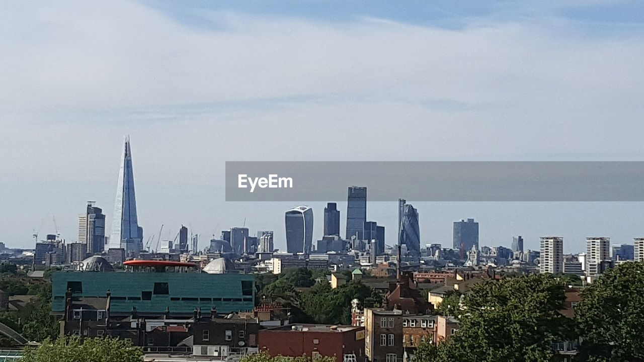 skyscraper, architecture, cityscape, city, building exterior, tall - high, urban skyline, sky, built structure, tower, modern, downtown district, cloud - sky, travel destinations, day, no people, outdoors