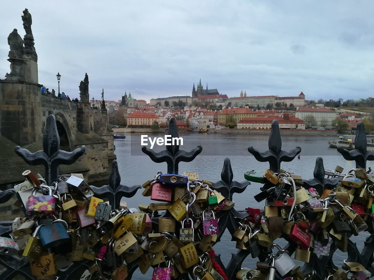 built structure, architecture, sky, building exterior, cloud - sky, city, day, nature, padlock, lock, travel destinations, human representation, art and craft, representation, the past, protection, history, security, transportation, safety, outdoors, bridge - man made structure, love lock, no people
