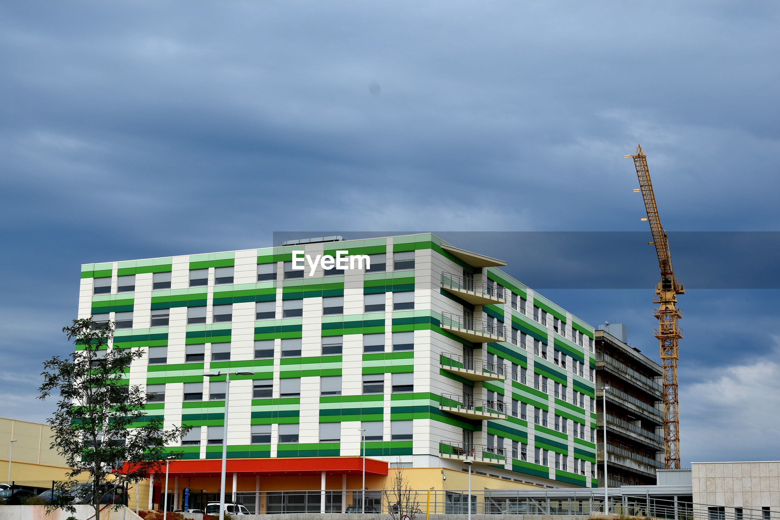 LOW ANGLE VIEW OF BUILDING AT CONSTRUCTION SITE AGAINST SKY