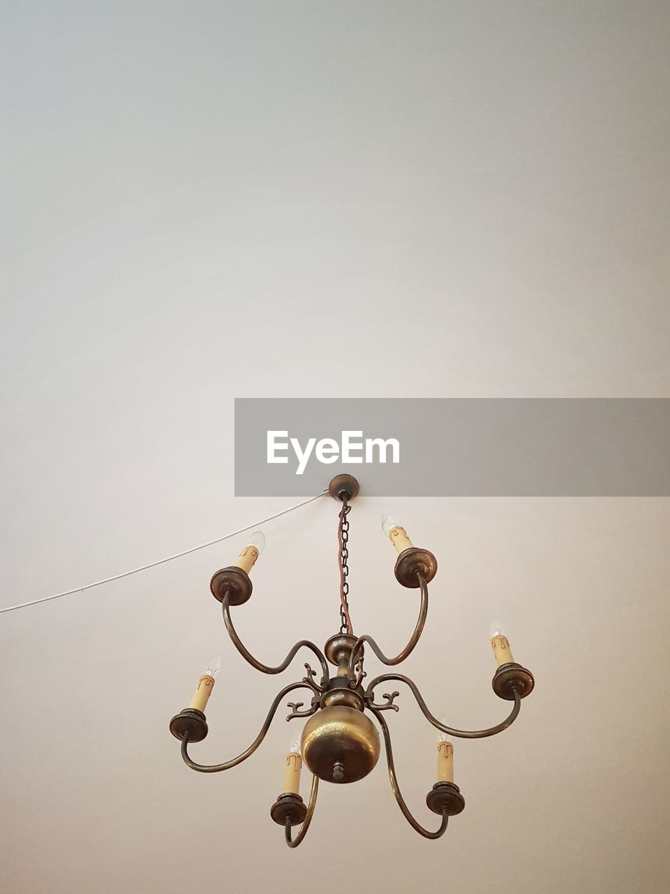 Low Angle View Of Chandelier Hanging On Ceiling
