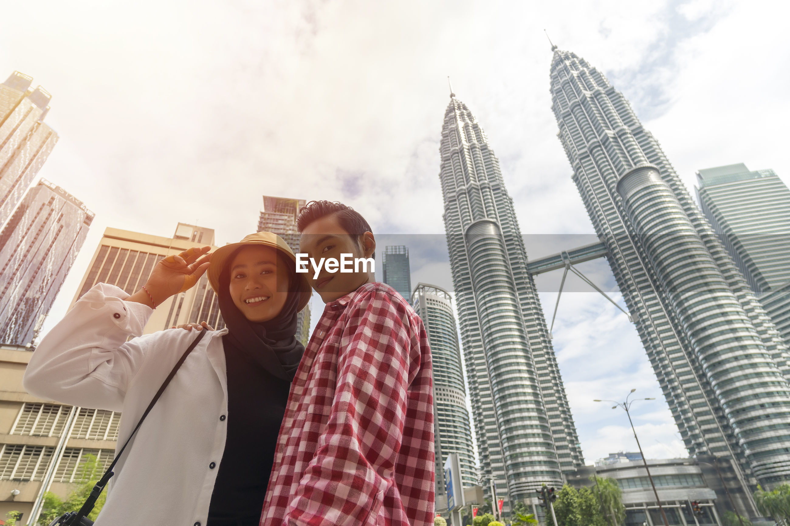 Travel concept, portrait of cute malay asian couple outdoor
