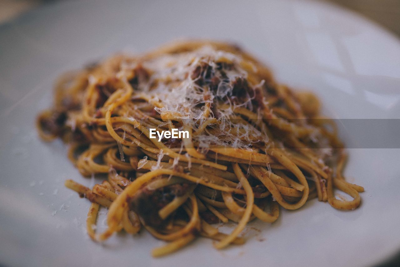 food, food and drink, ready-to-eat, freshness, still life, selective focus, close-up, indoors, pasta, plate, italian food, no people, serving size, indulgence, wellbeing, healthy eating, high angle view, spaghetti, table, sweet food, temptation, dinner, snack