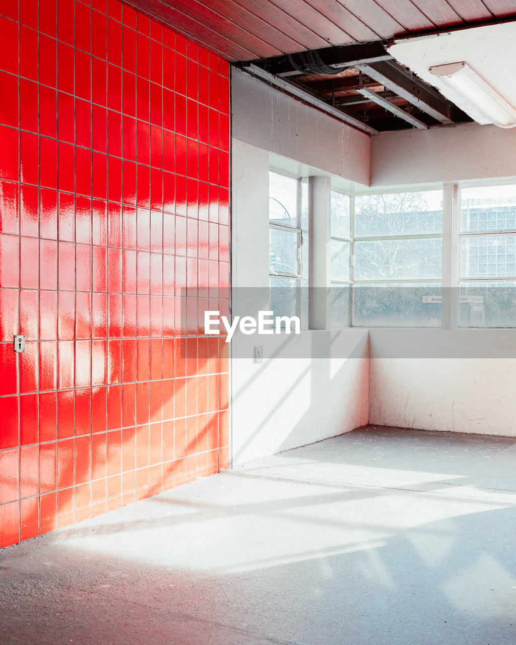 window, architecture, sunlight, indoors, day, built structure, building, no people, red, flooring, nature, wall - building feature, shadow, absence, glass - material, empty, modern, wall, domestic room, brightly lit, ceiling, tiled floor