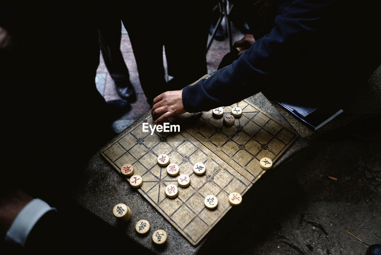 High Angle View Of Men Playing A Board Game