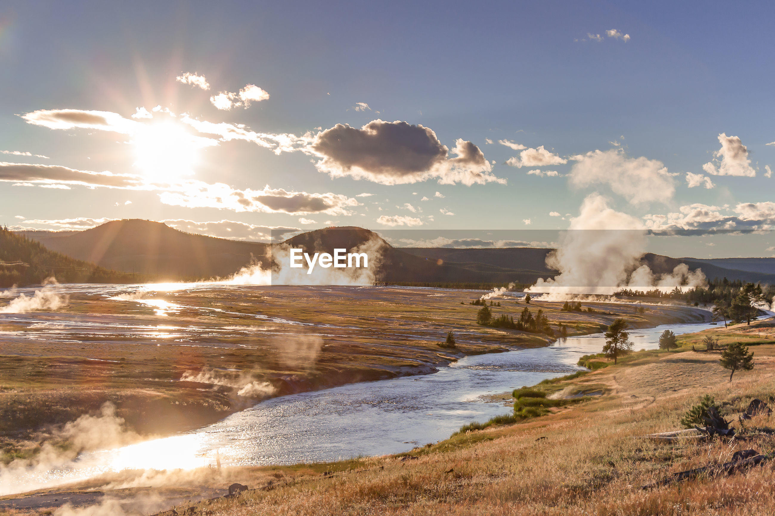 Steam rising from hot springs of midway geyser basin in yellowstone national park, wy, usa.