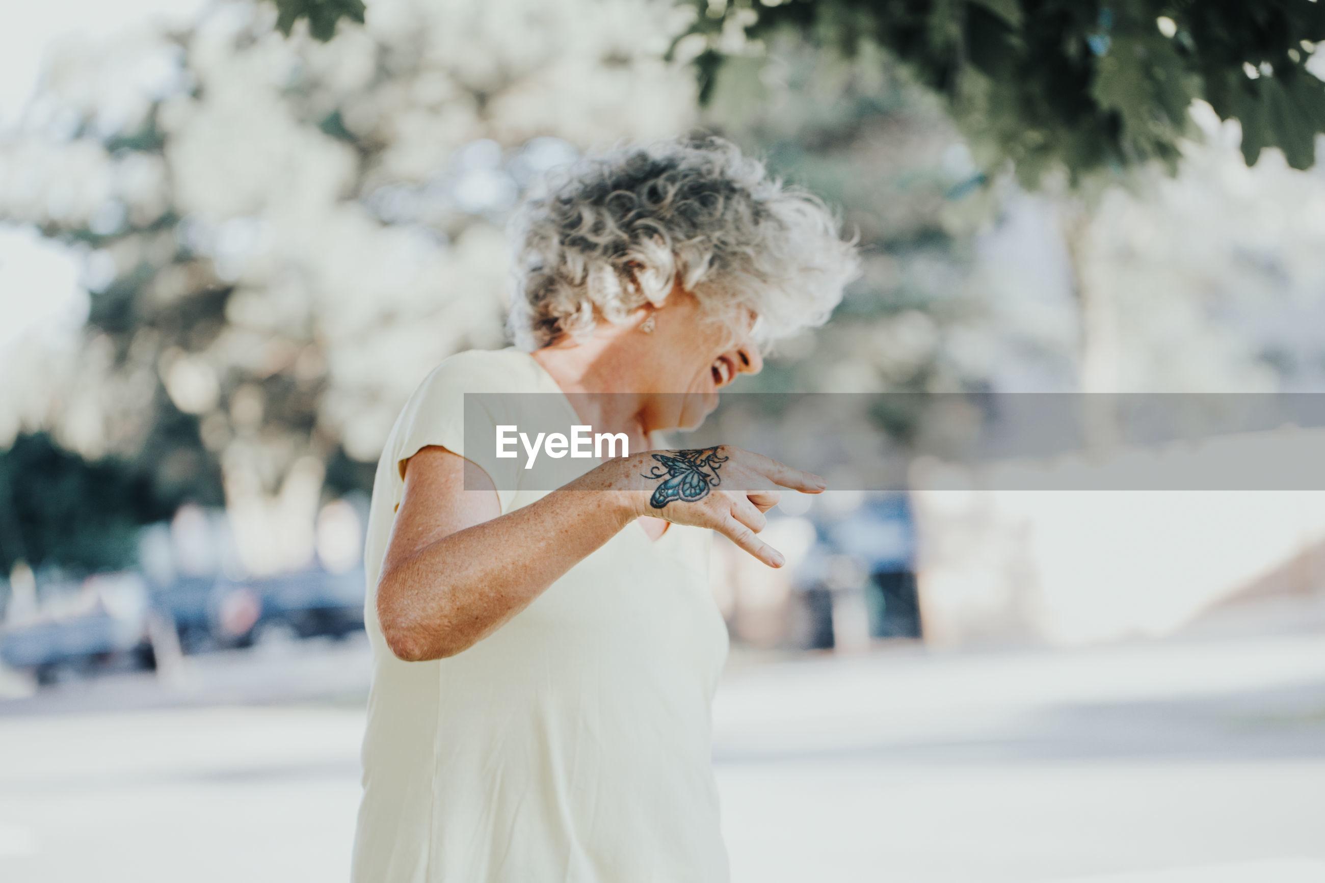 Senior woman standing outdoors