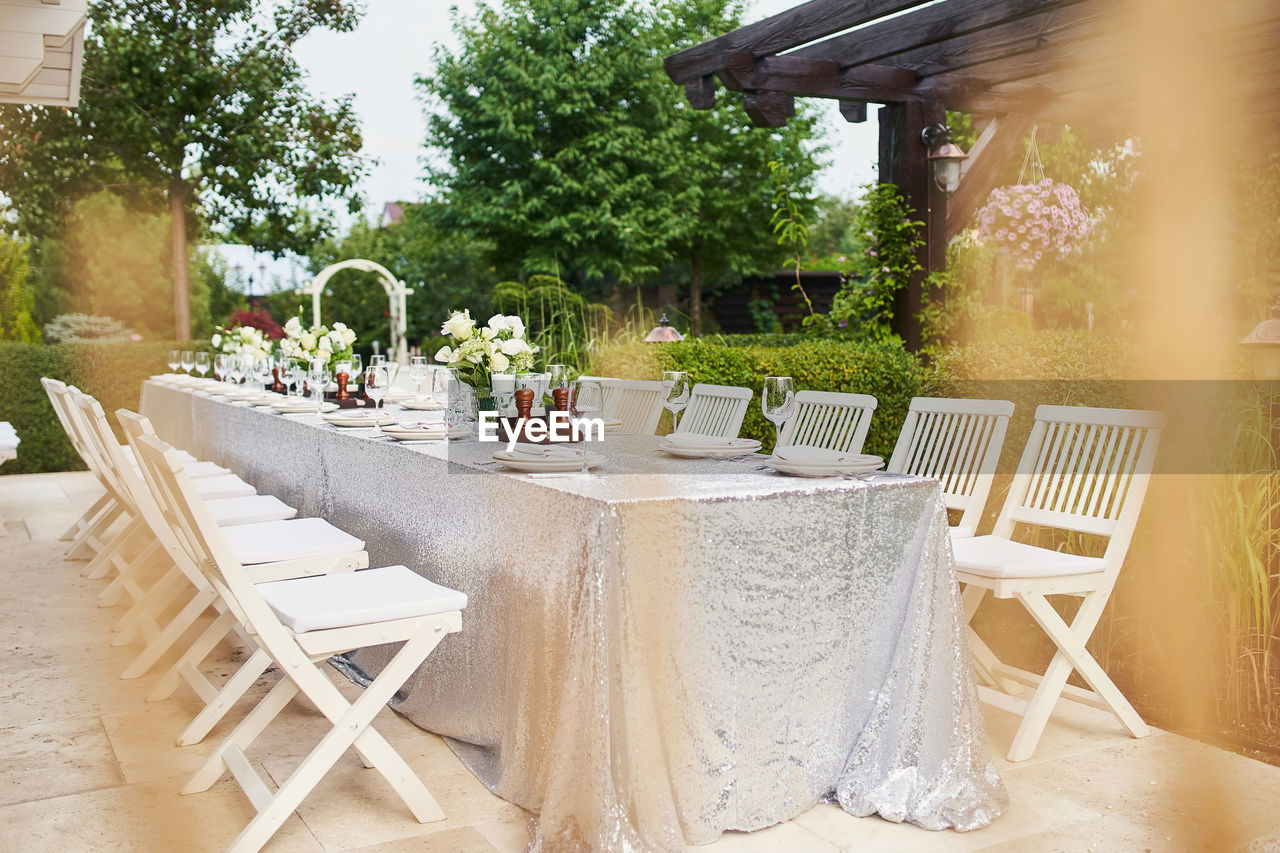 EMPTY CHAIRS AND TABLES AT YARD