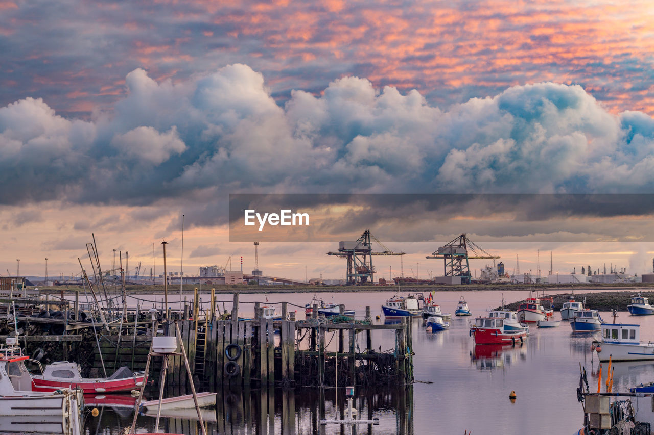 cloud - sky, water, sky, transportation, nautical vessel, mode of transportation, architecture, harbor, sea, nature, built structure, waterfront, no people, pier, industry, moored, commercial dock, sunset, building exterior, outdoors, port, sailboat, marina