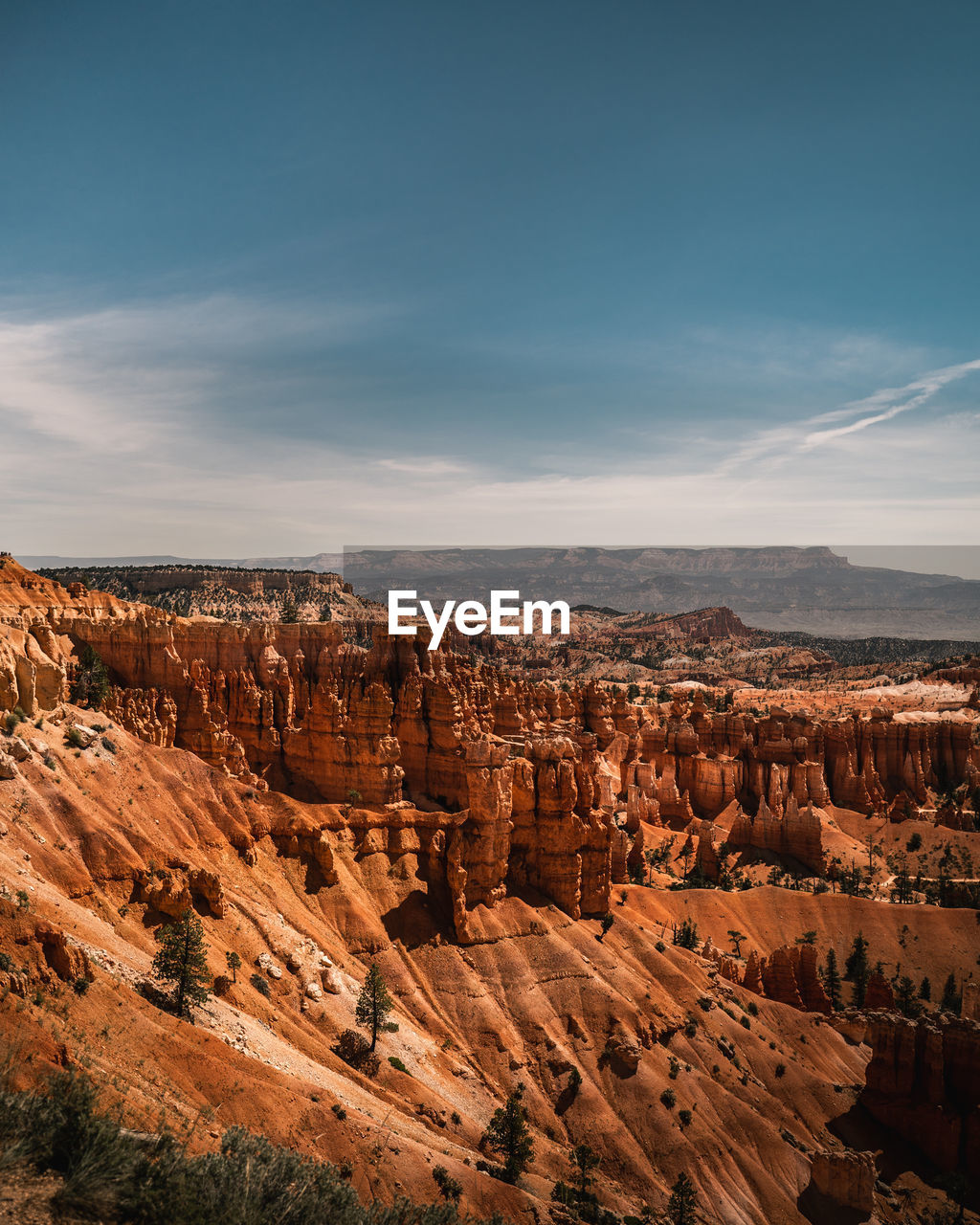 AERIAL VIEW OF ROCK FORMATION AGAINST SKY