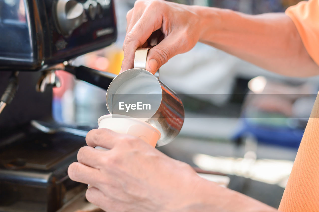 Cropped Image Of Person Preparing Coffee