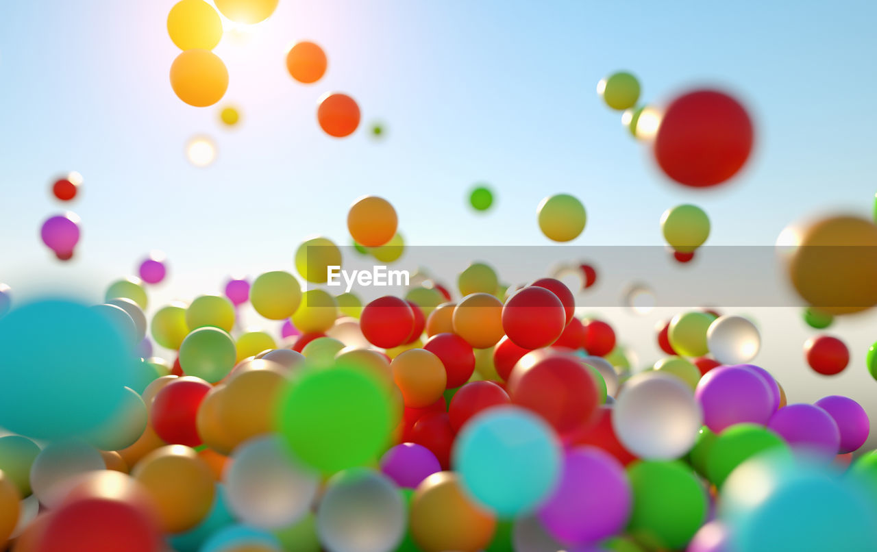 multi colored, large group of objects, no people, abundance, balloon, variation, shape, celebration, sky, selective focus, mid-air, choice, backgrounds, day, indoors, full frame, party - social event, design, nature