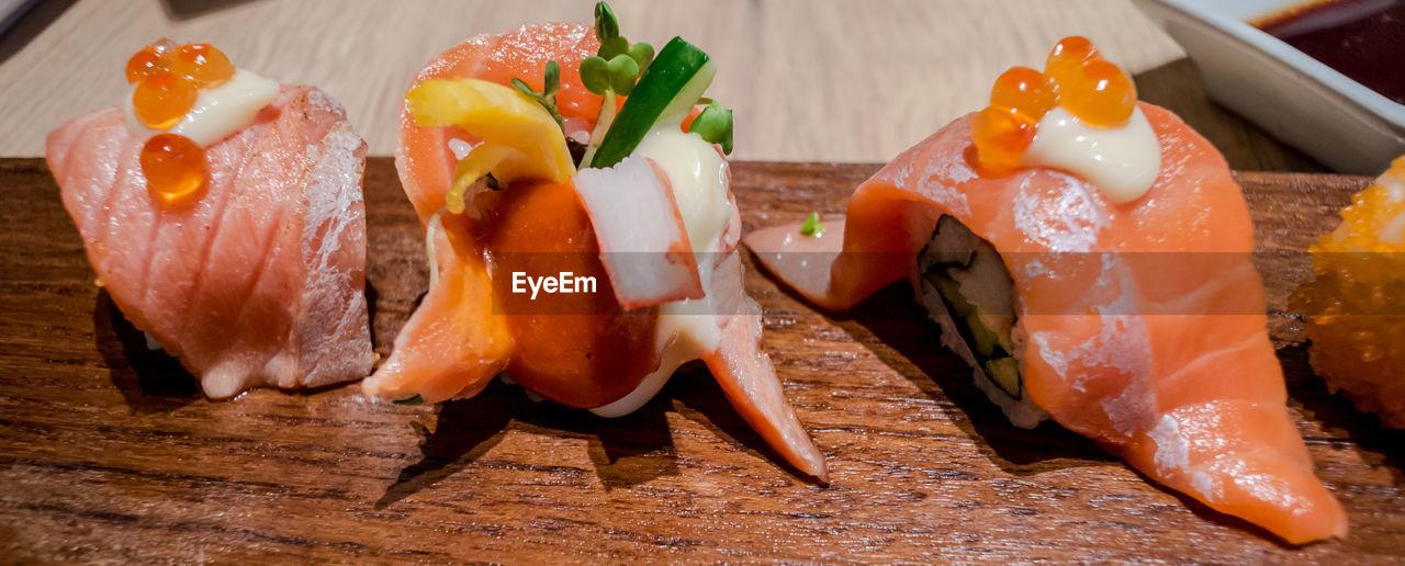 Close-Up Of Sushi On Wood