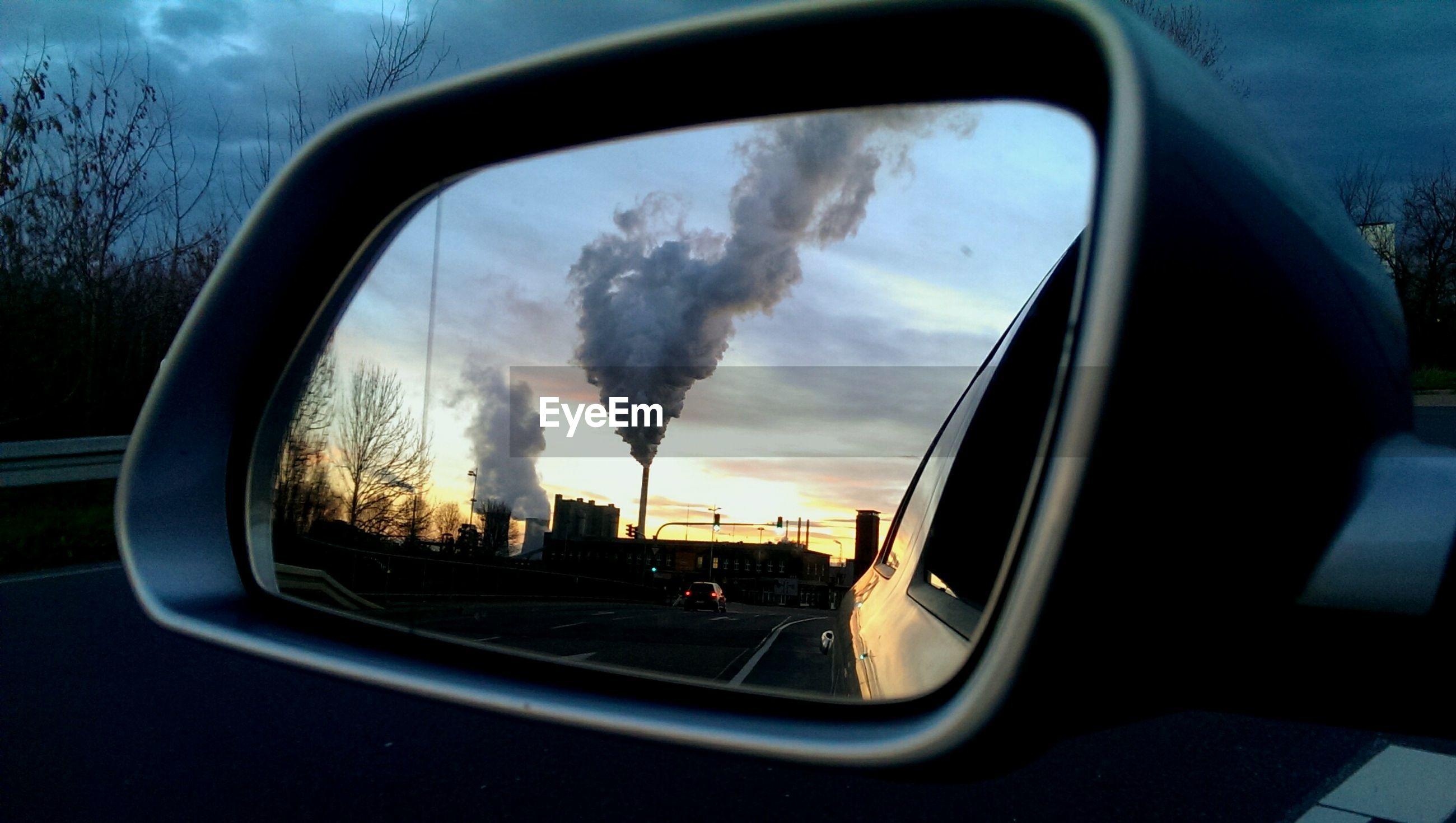 SUNSET SEEN THROUGH CAR WINDSHIELD