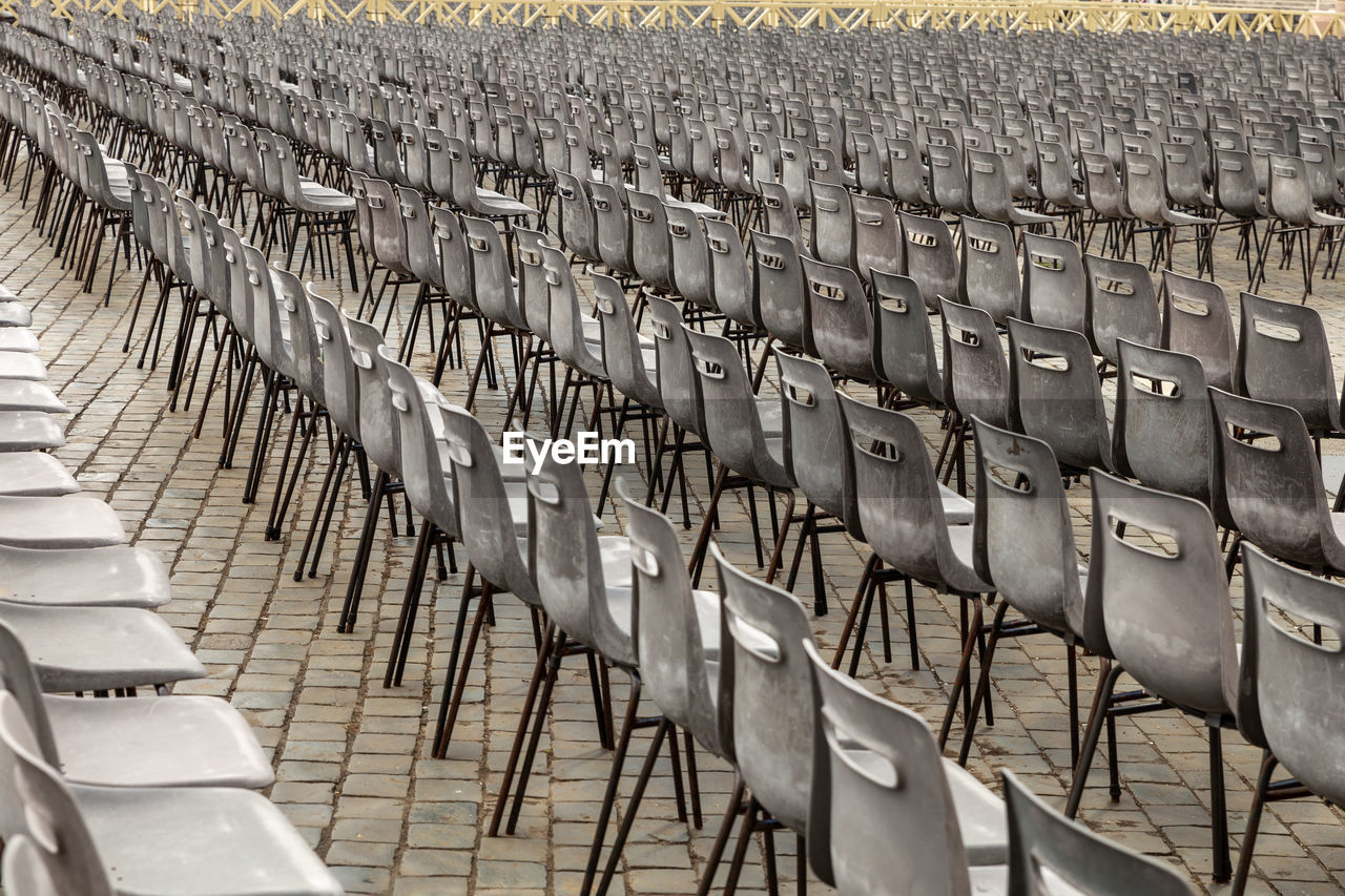 High Angle View Of Empty Chairs In Row