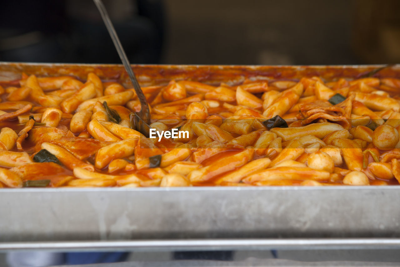 High Angle View Of Fresh Tteokbokki And Ladle In Tray