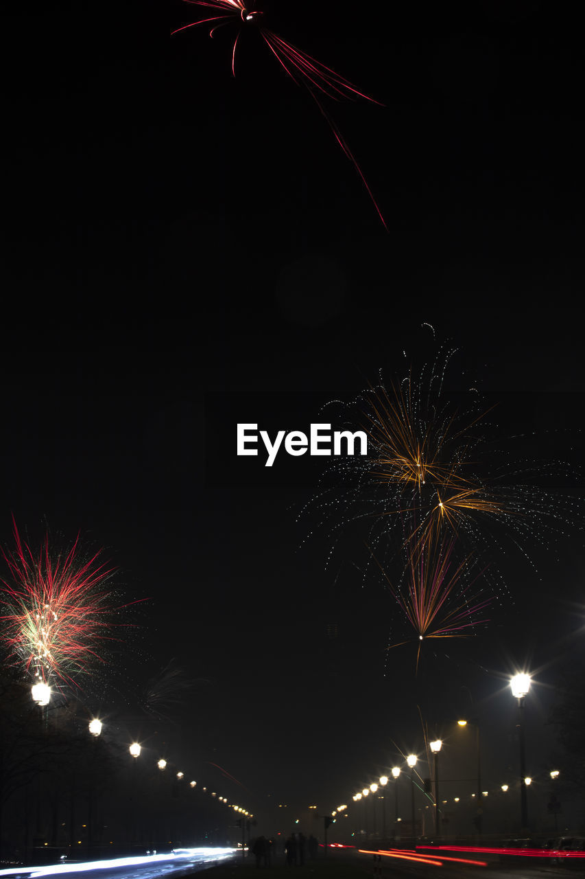 night, illuminated, firework, firework display, motion, celebration, exploding, long exposure, arts culture and entertainment, firework - man made object, sky, architecture, glowing, no people, event, nature, low angle view, building exterior, sparks, light, outdoors